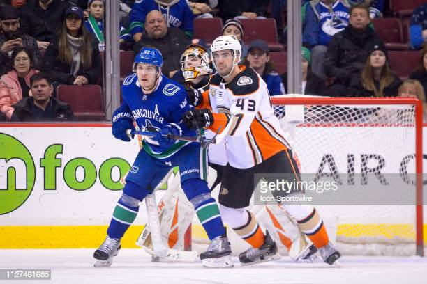 Vancouver Canucks Center Bo Horvat stands in front of Anaheim Ducks Goalie Kevin Boyle as Defenceman Jaycob Megna defends during their NHL game at...