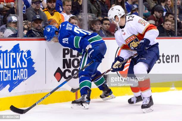 Vancouver Canucks Center Brandon Sutter and Florida Panthers Defenceman Mark Pysyk battle for the puck during their NHL game at Rogers Arena on...