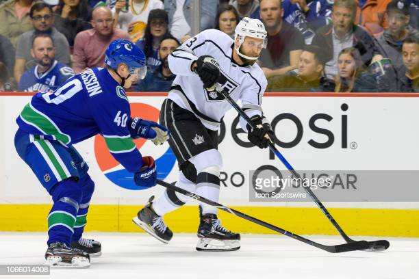 Vancouver Canucks Center Elias Pettersson defends against Los Angeles Kings Left Wing Kyle Clifford during their NHL game at Rogers Arena on November...