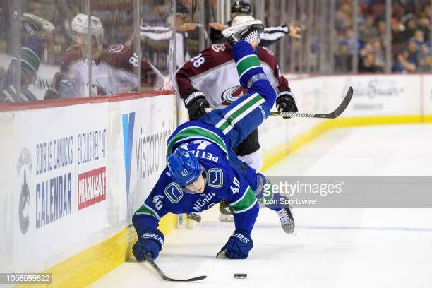Vancouver Canucks center Elias Pettersson is checked by Colorado Avalanche Defenceman Ian Cole during their NHL game at Rogers Arena on November 2,...