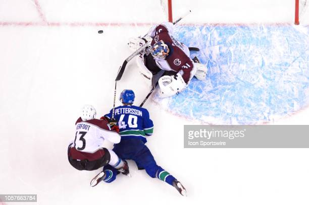 Vancouver Canucks center Elias Pettersson is taken down by Colorado Avalanche Left Wing Alexander Kerfoot during their NHL game at Rogers Arena on...
