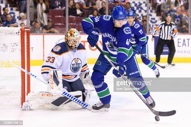 Vancouver Canucks center Elias Pettersson plays the puck in front of Edmonton Oilers goaltender Cam Talbot during their NHL preseason game at Rogers...