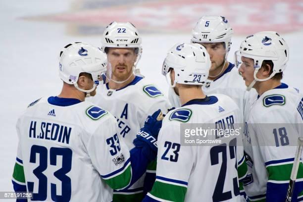Vancouver Canucks Center Henrik Sedin talks to teammates Left Wing Daniel Sedin Defenceman Alexander Edler Defenceman Derrick Pouliot and Right Wing...
