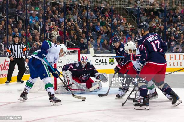 Vancouver Canucks center Jay Beagle attempts a shot on goal as Columbus Blue Jackets goaltender Joonas Korpisalo defends in a game between the...