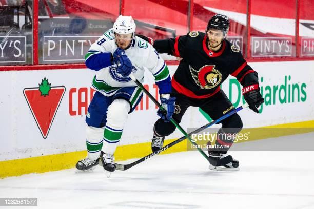 Vancouver Canucks Center J.T. Miller battles Ottawa Senators Defenceman Artem Zub along the boards during first period National Hockey League action...
