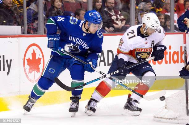 Vancouver Canucks Center Reid Boucher and Florida Panthers Center Vincent Trocheck battle for the puck during their NHL game at Rogers Arena on...