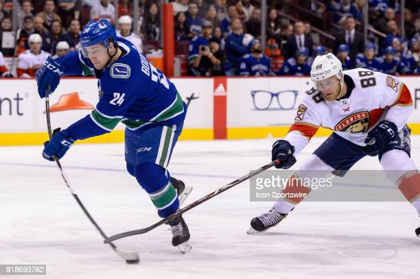 Vancouver Canucks Center Reid Boucher shoots the puck as Florida Panthers Left Wing Jamie McGinn defends during their NHL game at Rogers Arena on...