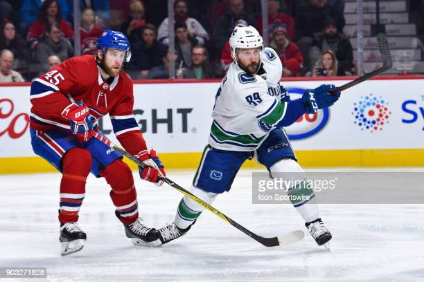 Vancouver Canucks Center Sam Gagner gets rid of the puck before Montreal Canadiens Defenceman Joe Morrow reaches him during the Vancouver Canucks...