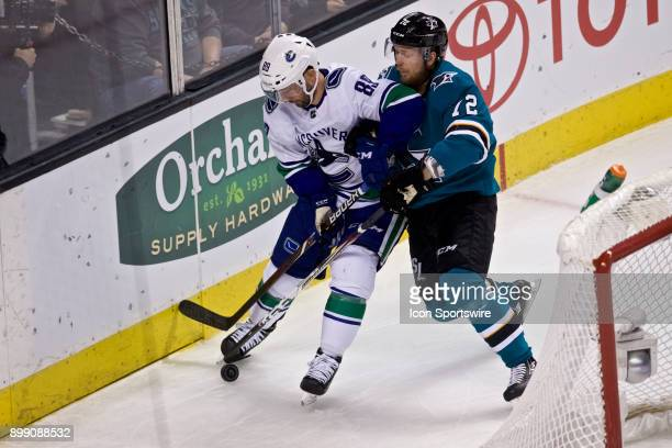Vancouver Canucks center Sam Gagner protects the puck from San Jose Sharks defenseman Tim Heed during the NHL game between the San Jose Sharks and...