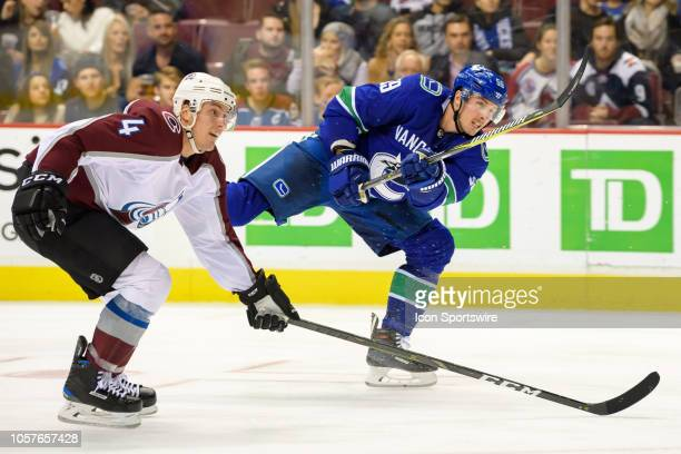 Vancouver Canucks center Tim Schaller takes a shot as Colorado Avalanche Defenceman Tyson Barrie defends during their NHL game at Rogers Arena on...