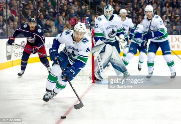 Vancouver Canucks center Tyler Motte controls the puck in a game between the Columbus Blue Jackets and the Vancouver Canucks on December 11 2018 at...