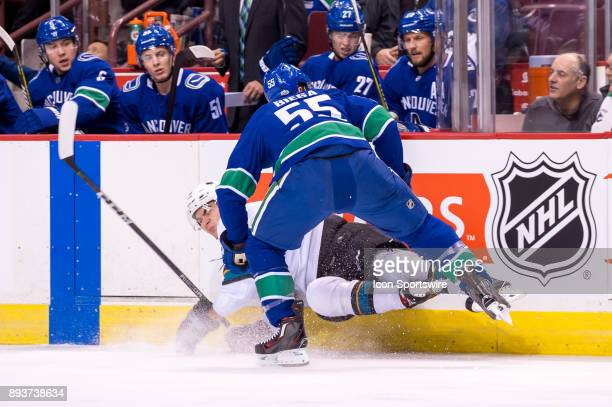 Vancouver Canucks Defenceman Alex Biega checks San Jose Sharks Left Wing Timo Meier to the ice during their NHL game at Rogers Arena on December 15...
