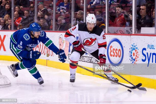 Vancouver Canucks Defenceman Chris Tanev defends against New Jersey Devils Left Wing Taylor Hall during their NHL game at Rogers Arena on November 1...