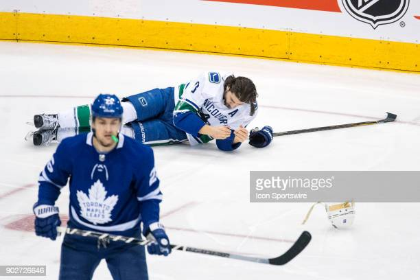 Vancouver Canucks Defenceman Chris Tanev on the ice after losing a tooth during the regular season NHL game between the Vancouver Canucks and the...