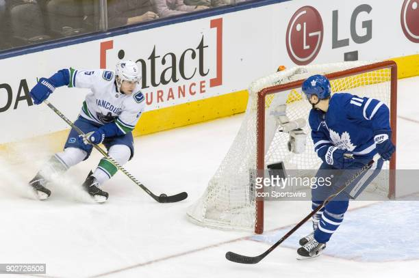 Vancouver Canucks Defenceman Derrick Pouliot changes direction against Toronto Maple Leafs Left Wing Zach Hyman during the regular season NHL game...