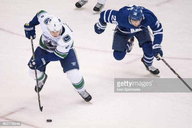 Vancouver Canucks Defenceman Derrick Pouliot is chased by Toronto Maple Leafs Right Wing Connor Brown during the regular season NHL game between the...