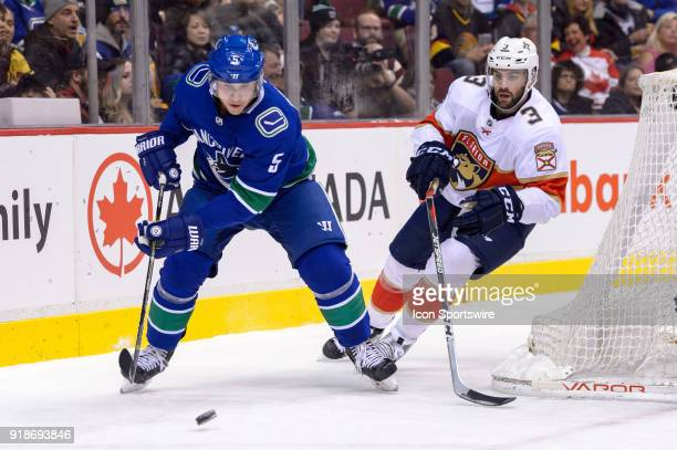 Vancouver Canucks Defenceman Derrick Pouliot plays the puck ahead of Florida Panthers Defenceman Keith Yandle during their NHL game at Rogers Arena...