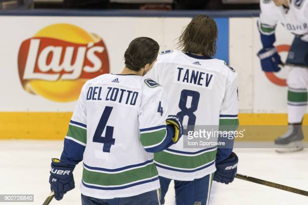 Vancouver Canucks Defenceman Michael Del Zotto follows teammate Defenceman Chris Tanev as they both leave the ice after the team warmup before the...