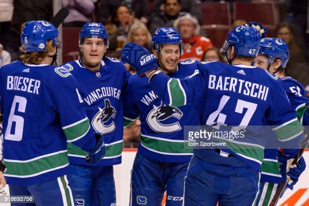 Vancouver Canucks Defenceman Michael Del Zotto is congratulated by players after scoring a goal during their NHL game against the Florida Panthers at...