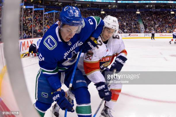 Vancouver Canucks Defenceman Troy Stecher is checked by Florida Panthers Winger Denis Malgin during their NHL game at Rogers Arena on February 14...