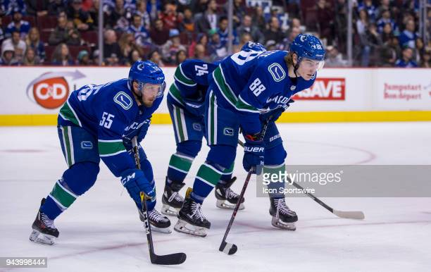 VANCOUVER BC MARCH 31 Vancouver Canucks Defenseman Alex Biega and Center Adam Gaudette during a stop in play in the second period in a NHL hockey...