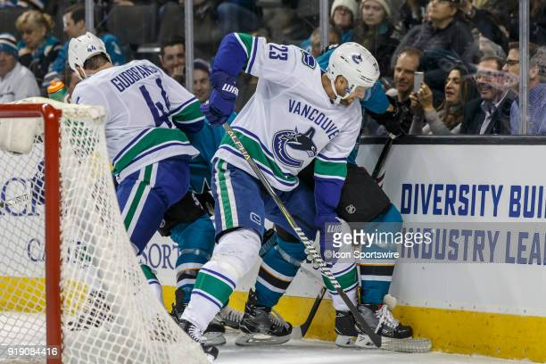 Vancouver Canucks defenseman Alexander Edler and defenseman Erik Gudbranson fight for the puck behind their goal during the first period of the...