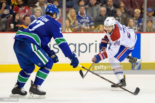 Vancouver Canucks defenseman Ben Hutton defends against Montreal Canadiens center Phillip Danault during their NHL game at Rogers Arena on November...