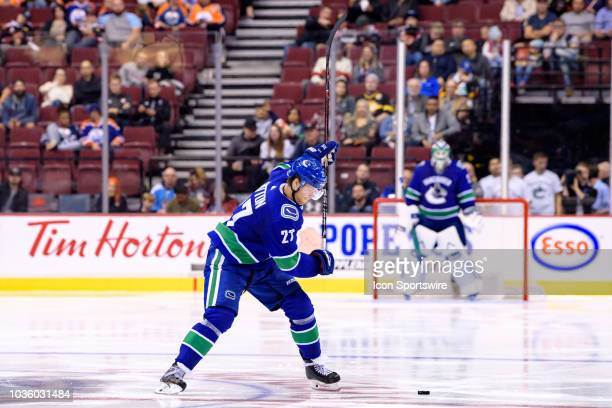 Vancouver Canucks defenseman Ben Hutton takes a shot during their NHL preseason game against the Edmonton Oilers at Rogers Arena on September 18 2018...