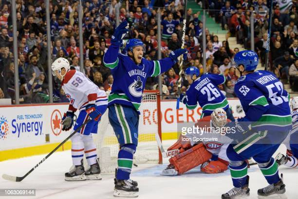 Vancouver Canucks defenseman Michael Del Zotto celebrates after scoring a goal on Montreal Canadiens goalie Carey Price during their NHL game at...