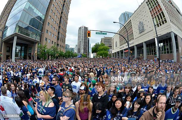Vancouver Canucks fans gather at a view site to watch Game Six of the 2011 NHL Stanley Cup Playoffs on June 13, 2011 in downtown Vancouver, British...