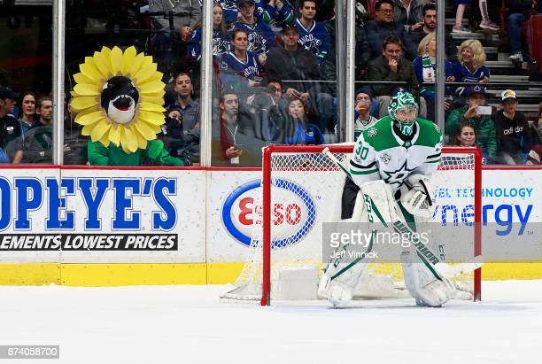 Vancouver Canucks Fin watches from behind the net as Ben Bishop of the Dallas Stars looks on from his crease during their NHL game at Rogers Arena...