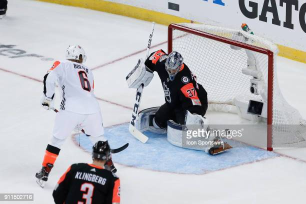 Vancouver Canucks forward Brock Boeser scores on Winnipeg Jets goalie Connor Hellebuyck during the 2018 NHL AllStar Game between the Pacific Division...