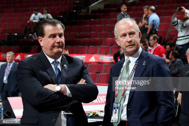 Vancouver Canucks general manager Jim Benning meets with Dallas Stars general manager Jim Nill during the 2017 NHL Draft at the United Center on June...