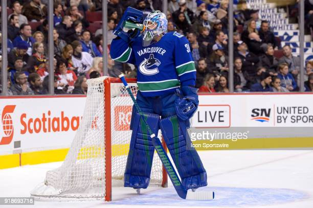 Vancouver Canucks Goalie Anders Nilsson takes a drink during their NHL game against the Florida Panthers at Rogers Arena on February 14 2018 in...