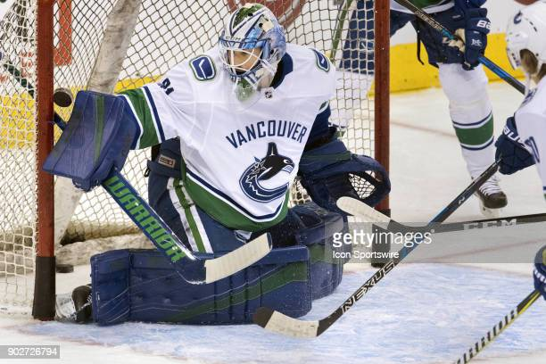 Vancouver Canucks Goalie Anders Nilsson watches a puck shot by a teammate during the team warmup before the regular season NHL game between the...