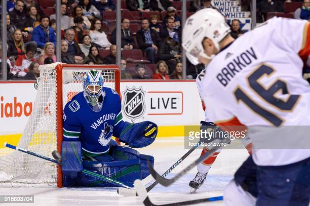 Vancouver Canucks Goalie Anders Nilsson watches a shot by Florida Panthers Center Aleksander Barkov during their NHL game at Rogers Arena on February...