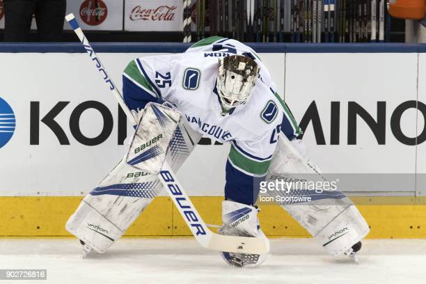 Vancouver Canucks Goalie Jacob Markstrom collects puck at the end of the team warmup before the regular season NHL game between the Vancouver Canucks...