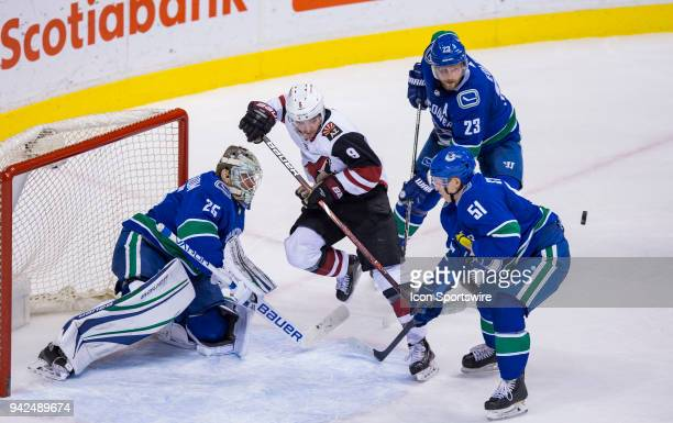 Vancouver Canucks Goalie Jacob Markstrom makes a save on Arizona Coyotes Winger Clayton Keller as Defenseman Troy Stecher and Defenseman Alexander...