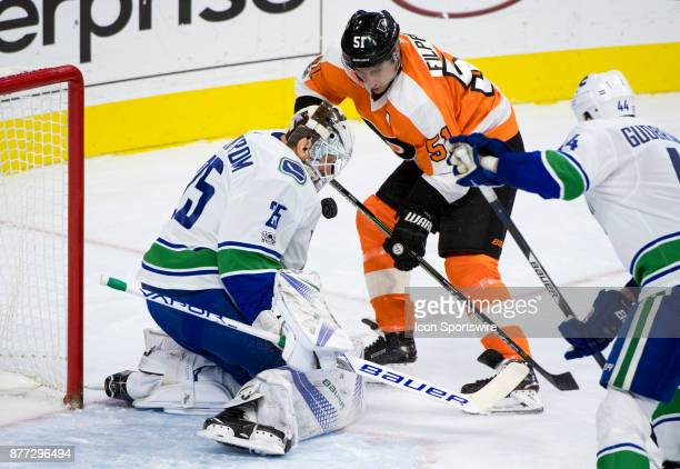 Vancouver Canucks Goalie Jacob Markstrom saves a shot against Philadelphia Flyers Center Valtteri Filppula in the first period during the game...
