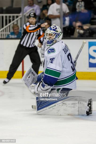 Vancouver Canucks goalie Richard Bachman looks frustrated as the referee signals a San Jose goal during the third period of the regular season game...