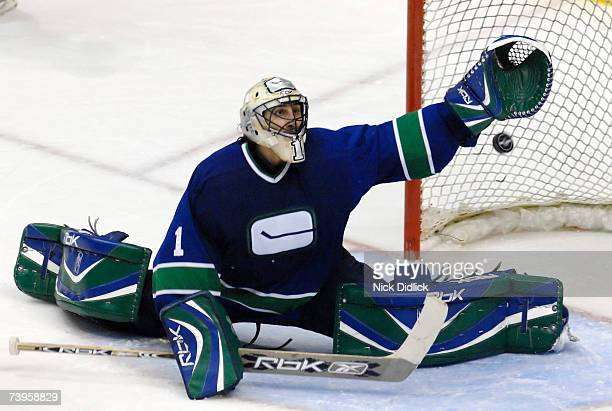 Vancouver Canucks goalie Roberto Luongo reaches to try and grab a shot out of the air during game seven of the 2007 Western Conference Quarterfinals...
