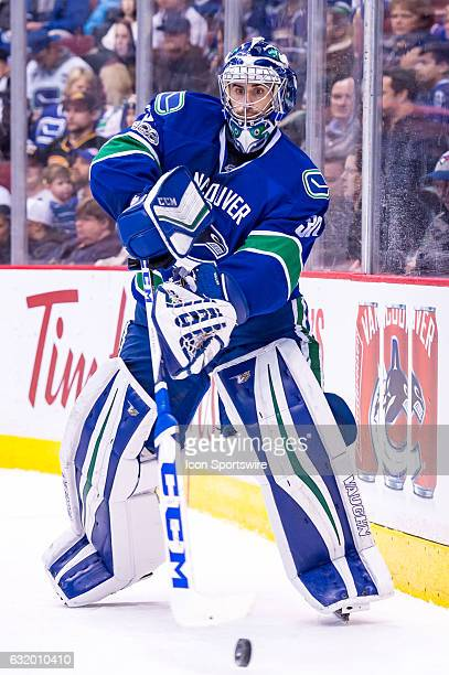 Vancouver Canucks Goalie Ryan Miller plays the puck against the Nashville Predators during their NHL game at Rogers Arena on January 17 2017 in...