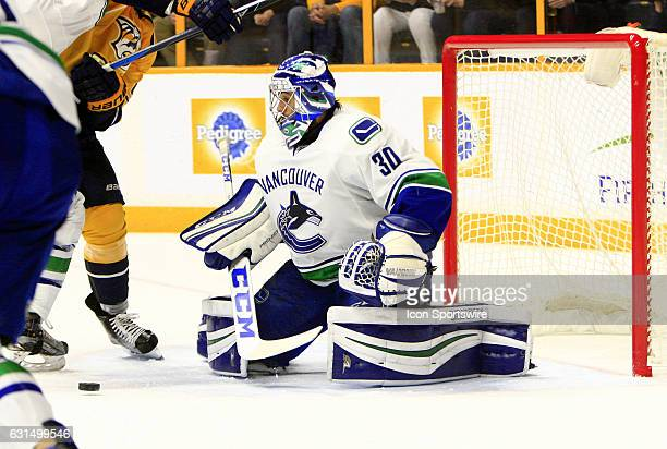 Vancouver Canucks goalie Ryan Miller prepares to cover the puck during the NHL game between the Nashville Predators and the Vancouver Canucks held on...