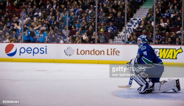 Vancouver Canucks Goalie Ryan Miller takes a knee while the off ice officials review a goal scored by San Jose Sharks Right Wing Joel Ward in the...