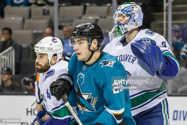 Vancouver Canucks goaltender Anders Nilsson and defenseman Erik Gudbranson wait with San Jose Sharks right wing Timo Meier in front of the Vancouver...