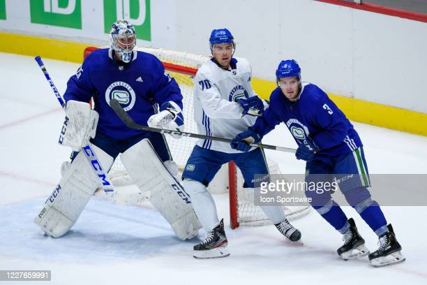 Vancouver Canucks Goaltender Jacob Markstrom and Defenseman Brogan Rafferty defend against Left Wing Tanner Pearson during the Vancouver Canucks...