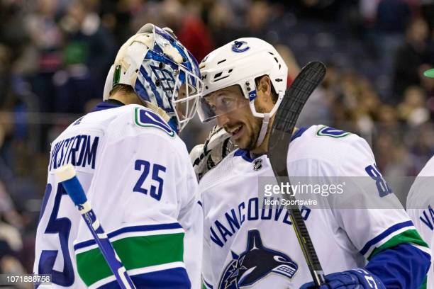 Vancouver Canucks goaltender Jacob Markstrom celebrates with Vancouver Canucks center Jay Beagle after winning a game between the Columbus Blue...