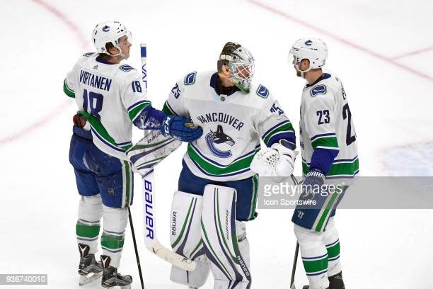 Vancouver Canucks goaltender Jacob Markstrom celebrates with Vancouver Canucks defenseman Alexander Edler and Vancouver Canucks right wing Jake...