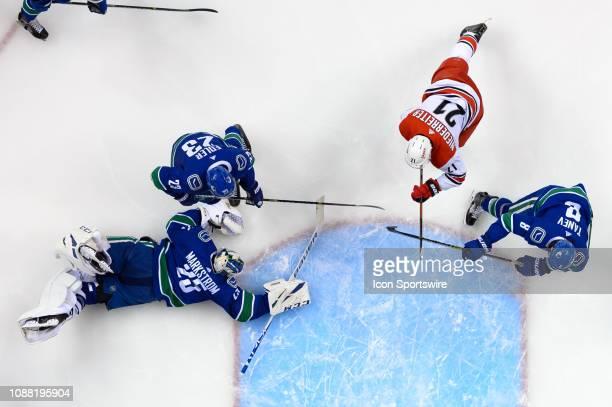 Vancouver Canucks Goaltender Jacob Markstrom makes a save as Defenseman Alexander Edler and Defenseman Christopher Tanev defend against Carolina...