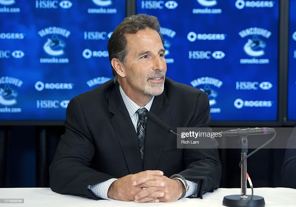 Vancouver Canucks head coach John Tortorella listens to a question during a press conference announcing him as the new head coach of the team, June 25, 2013 at Rogers Arena in Vancouver, British Columbia, Canada.